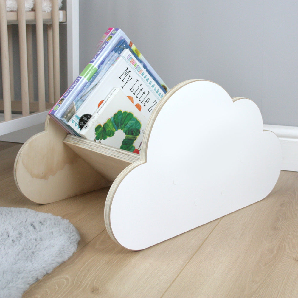 Cloud shaped book rack in nursery room.