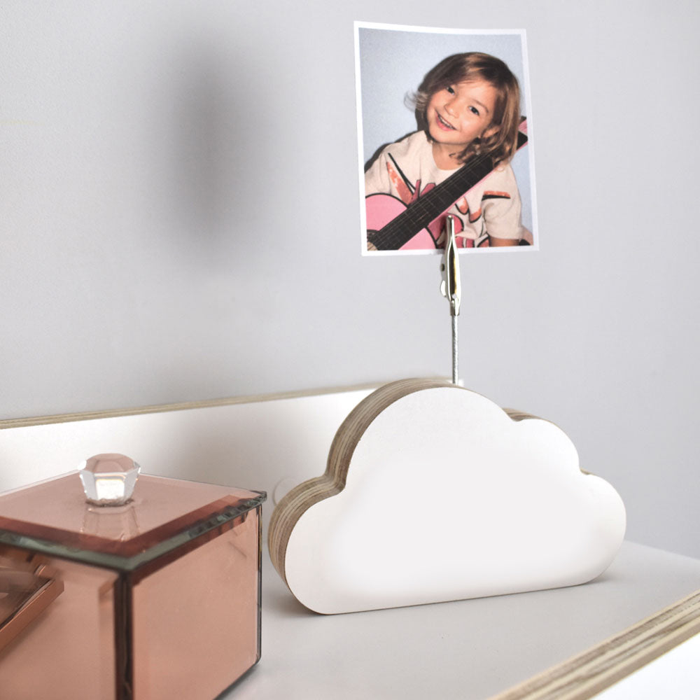 Children's cloud picture holder on a shelf in white.