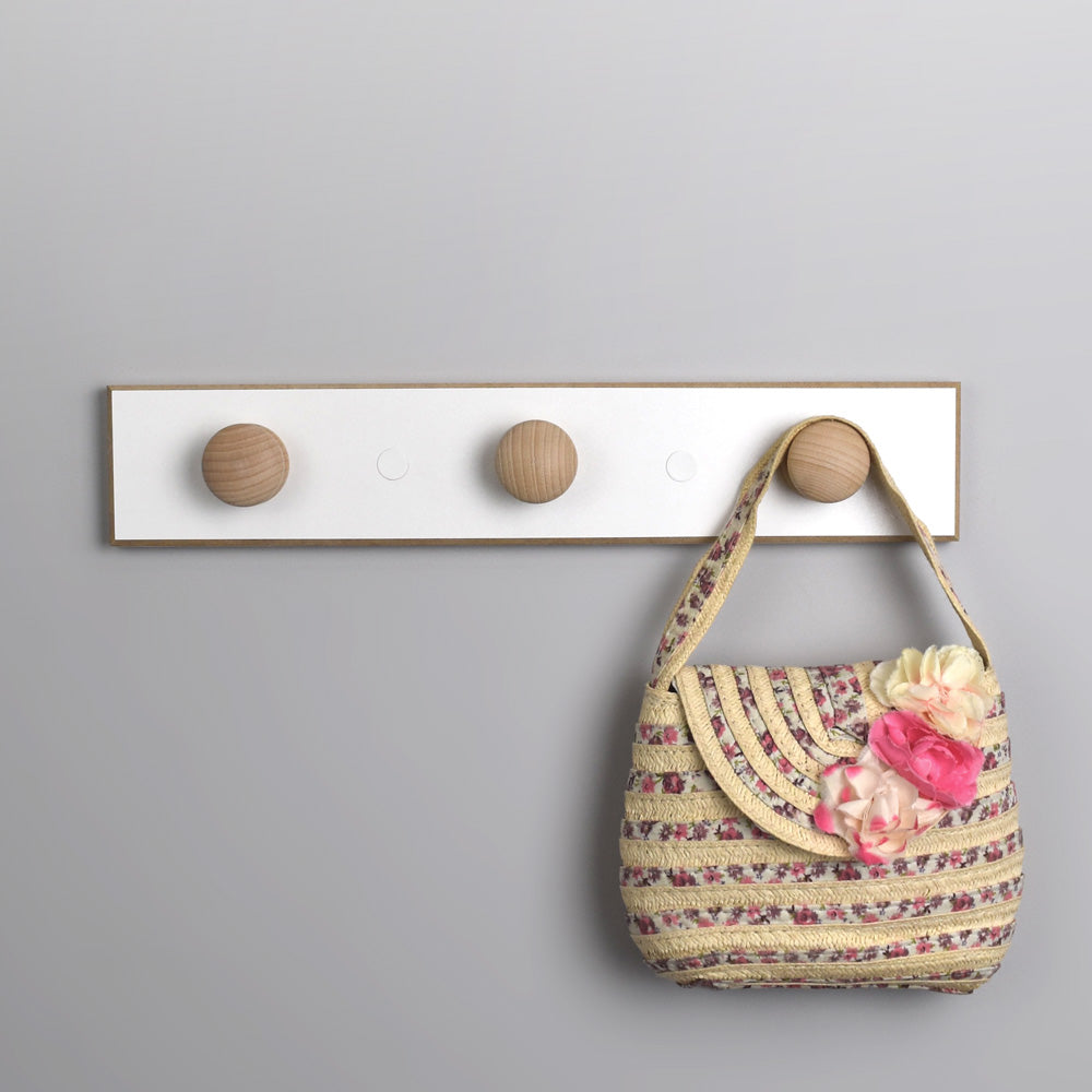 Wall mounted coat hangers with wooden knobs.