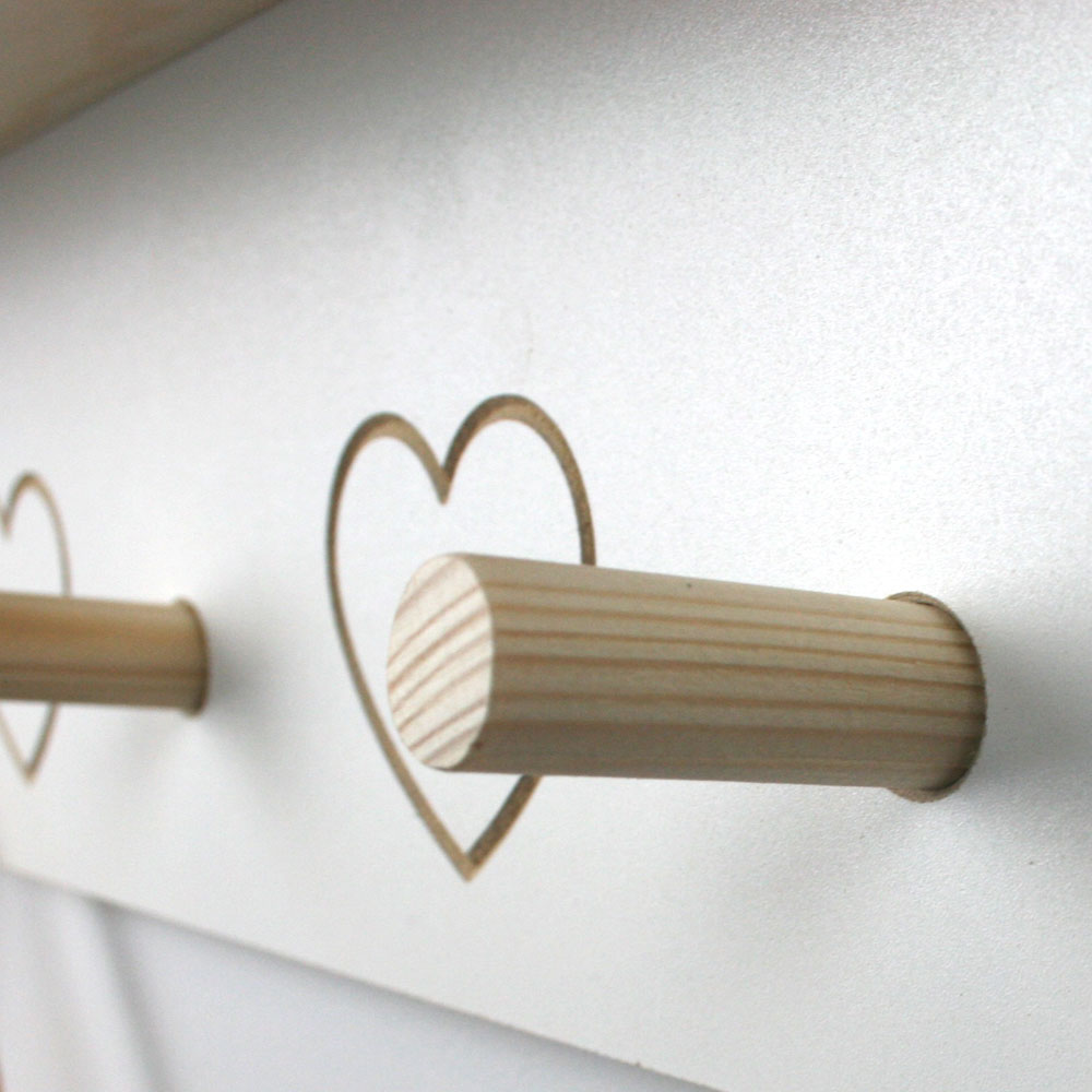 Wooden hanging pegs and engraved heart detail