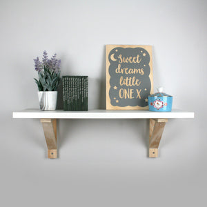 Wooden bracket mounted nursery shelf