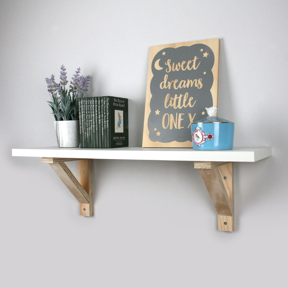 Wall mounted wooden bracket nursery shelf.