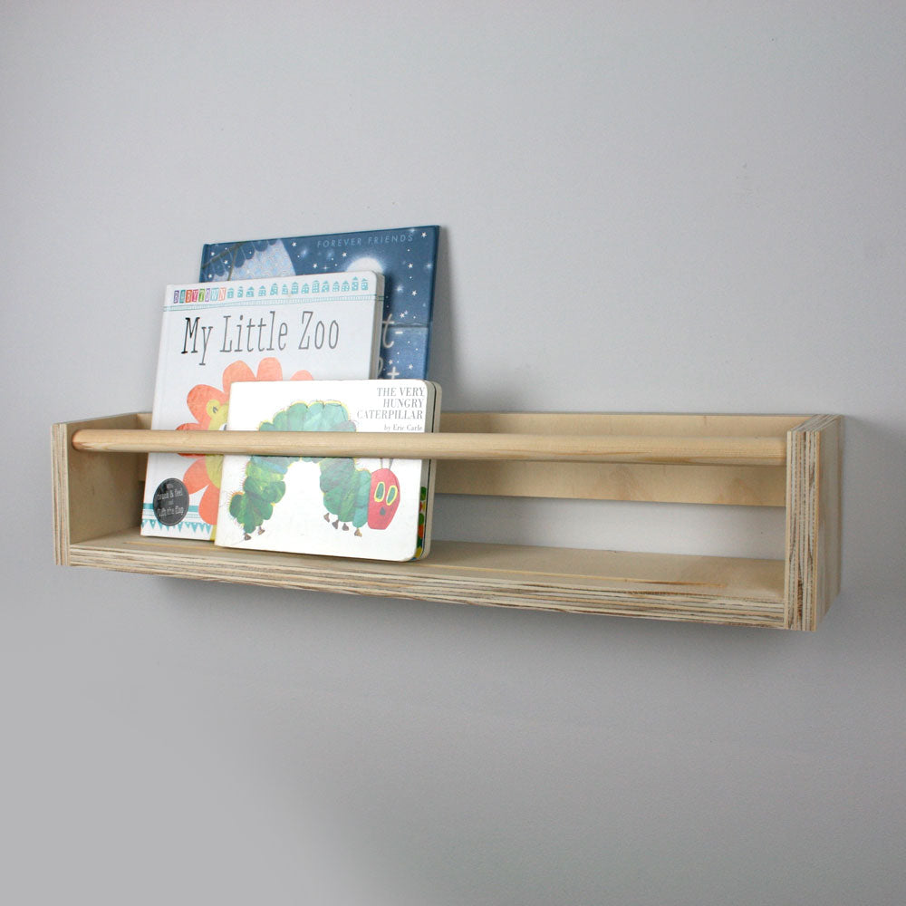 Side view of wooden wall book rack.