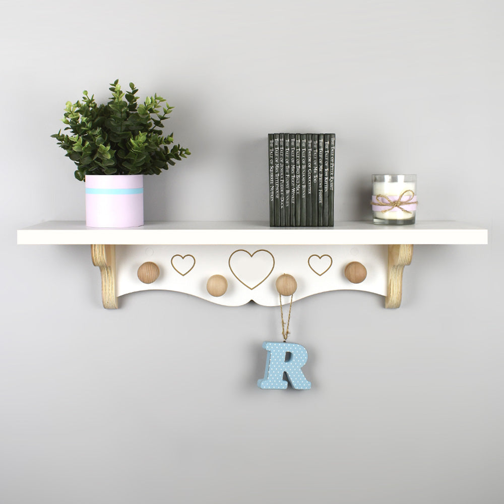 New baby personalised nursery shelf with wooden knob hangers.