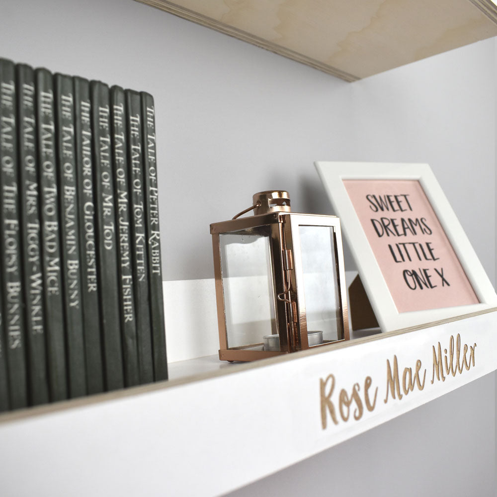 Shelf display on personalised wall shelf.