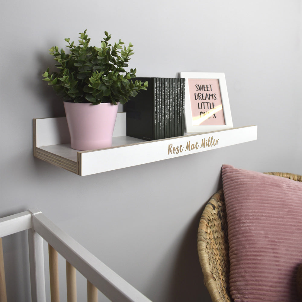 Nursery room scene with personalised wall shelf.
