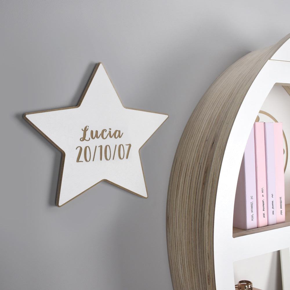 Wall mounted personalised star shaped door plaque.