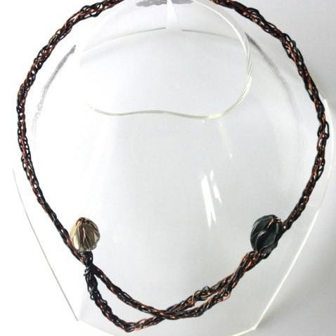 Turangawaewae - woven wire silver pod necklace - exhibition