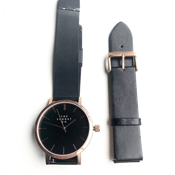 Rose gold quartz wrist watch - black steel & black leather straps