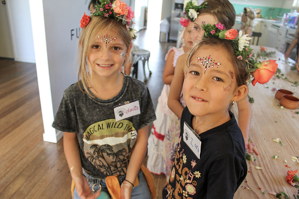 Charlie and Zara proudly display their flower crowns at the COTT Girls Club