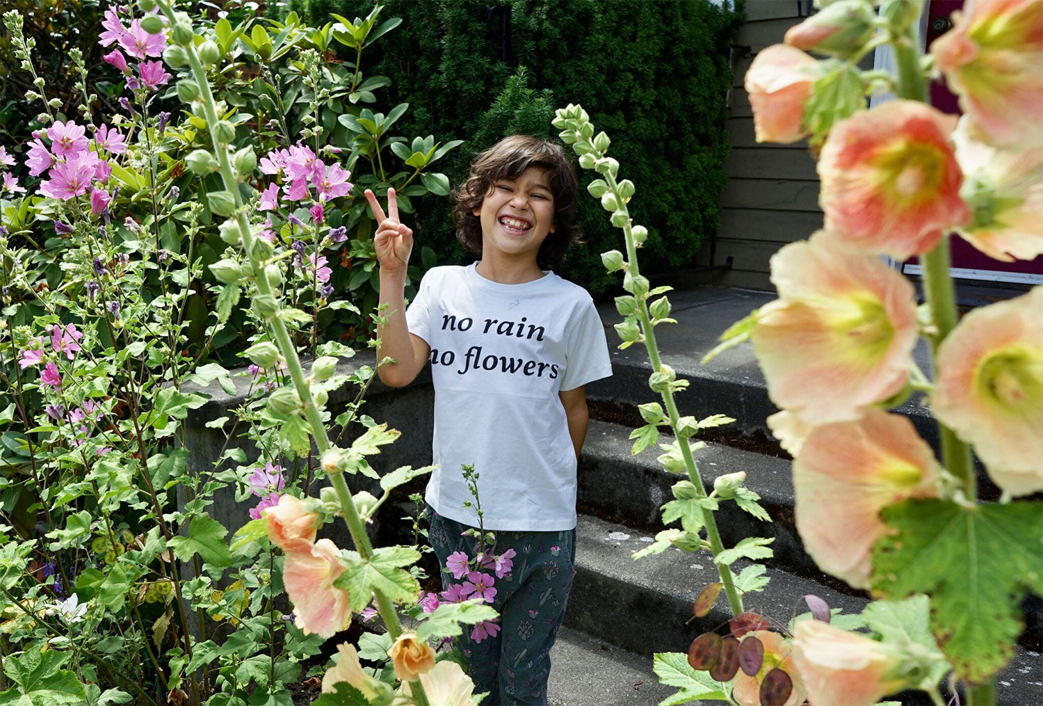 Beth's son wears the No Rain No Flowers Tee
