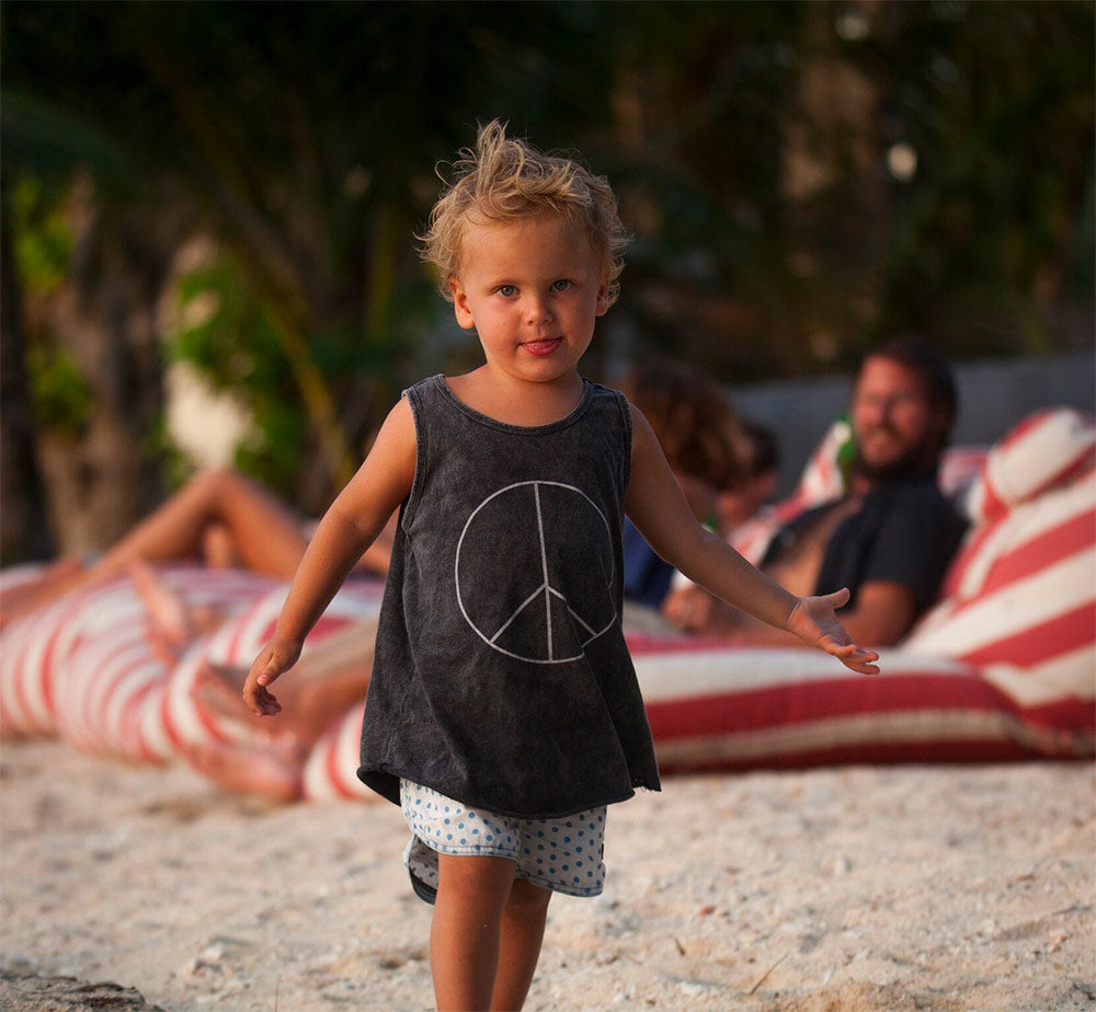 Lyon living in a jungle surf camp: Peace Singlet by Children of the Tribe