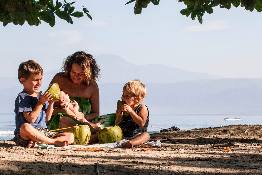 Jodie feeds her kids local fruit in Sumatra