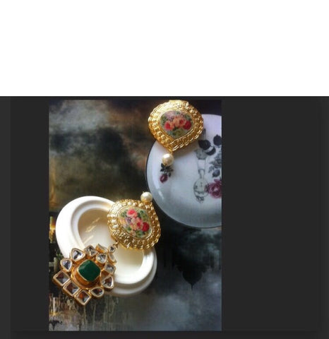 Print therapy kundan and floral earrings