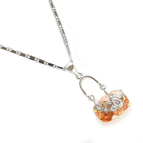 Cubic Zircon Style Swarovski Cut Crystal Pendant Necklace. A Solid Rounded Baguette Cut Crystal with a Love Bow Design in Clear Diamond. 5 Colours: Topaz, Siam Red, Jet Black, Clear and Amethyst