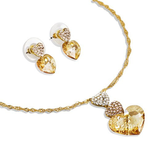 Swarovski® Hearts Trio Set; Stunning Single Swarovski Heart Crystal Pendant and Matching Earrings. 3 Hearts Pendant w/ final Heart a Single 15mm Gem Swarovski Crystalized Element. On fine Twisted 14K Gold Plated Chain In a Blue Swarovski