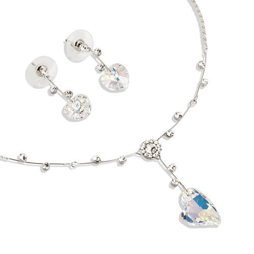 Swarovski® Hearts Twine Set; Stylised Stunning Single Swarovski Heart Crystal Pendant and Matching Earrings Set. A Twine setting w/ crystals mounted on Metal links. Pure Swarovski Crystal in Light Topaz on Gold, or AB Clear Rainbow on Rhodium or Gold.