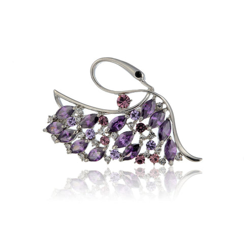The Paris Swan Brooch Pin Jewellery on an Exquisite Setting Combining Pear Drop Cut Crystals and Round Swarovski Crystals Set. 4 Colours: Emerald Green, Clear Diamond and Champagne& Rose Mix on 14K Gold and the Amethyst on a Silver Rhodium Option.
