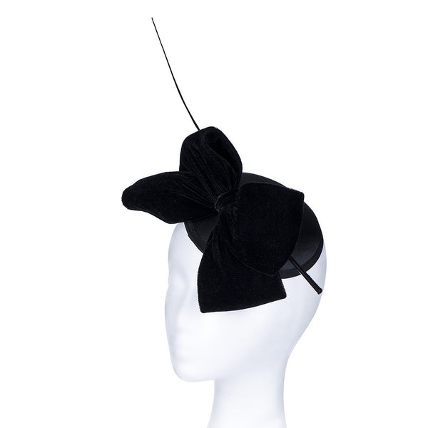 Janeo Middleton Style Mini Domed Pill Box Bow Fascinator Hat. Mini Round Satin Dome with a Large Luxurious Velvet Bow and a Single Quill. For Weddings or Special Occasions. Four Classic Versatile Colours: Black, Classic Red, Lavender Purple & Champagne