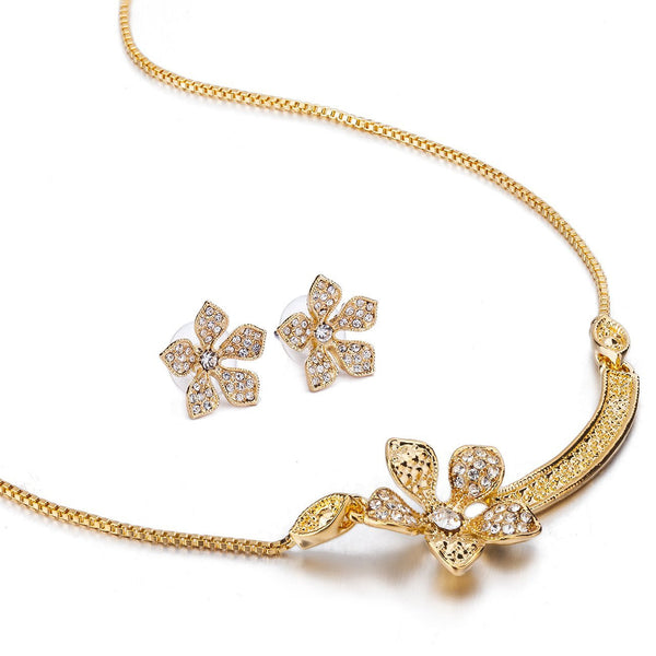 Stunning Miniature Lotus Leaf Swarovski Crystal Jewellery Set. Part of The Elizabeth Collection from Janeo. Delicate Single Flower Necklace w/ Petals Inlaid w/ Clear Crystals. Exquisite Matching Earrings. In 14k Gold & Antique Silver Rhodium Options.