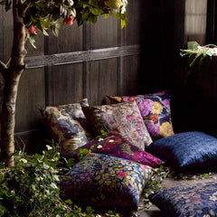 A selection of cushions covered in fabric from the secret garden collection by Liberty Art fabrics at decorrooms