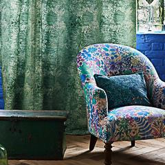 An armchair upholstered in fresco lagoon fabric by Liberty art fabrics. blof from decorrooms