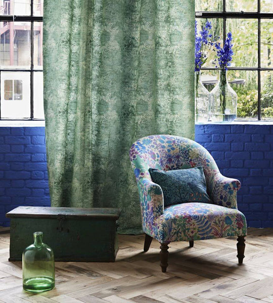 An armchair covered in Fresco lagoon fabric by Liberty | Decor Rooms