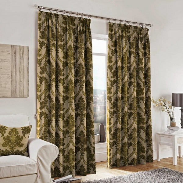Curtains and a cushion made from Canterbury Fern Green Fabric by Jim Dickens at Decor Rooms