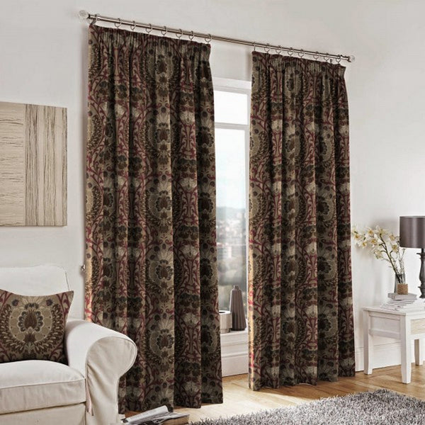 Curtains and a cushion made with Isfahan Damson Fabric by Jim Dickens at Decor Rooms