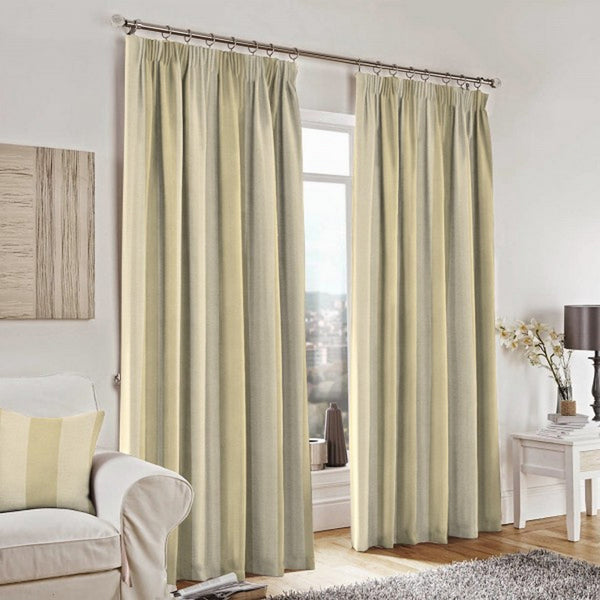 Curtains and a cushion made with Cuthbert Platinum Fabric by Jim Dickens at Decor Rooms