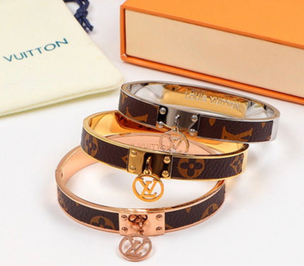 Louis Vuitton Titanium and Leather inlaid bracelet with LV Logo ring - 4 shades
