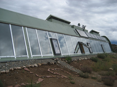 A solar system on the front face of an Earthship, Taos, New Mexico, USA – B. Trauth