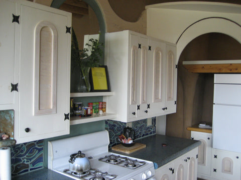 A beautiful kitchen in an Off Grid home, still limited by propane powered stoves and thus deliveries – B. Trauth