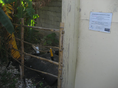 A methane digester powered by a human toilet in Port Au Prince, Haiti. This community toilet created enough methane to power the community kitchen.            – B. Trauth