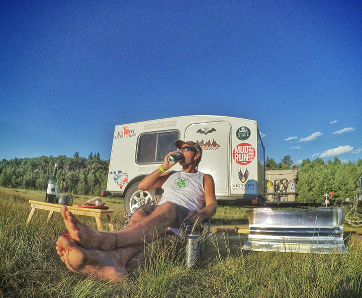 Living the #VanLife, Ultra Runner Patrick Sweeney cooks while relaxing from his latest race.
