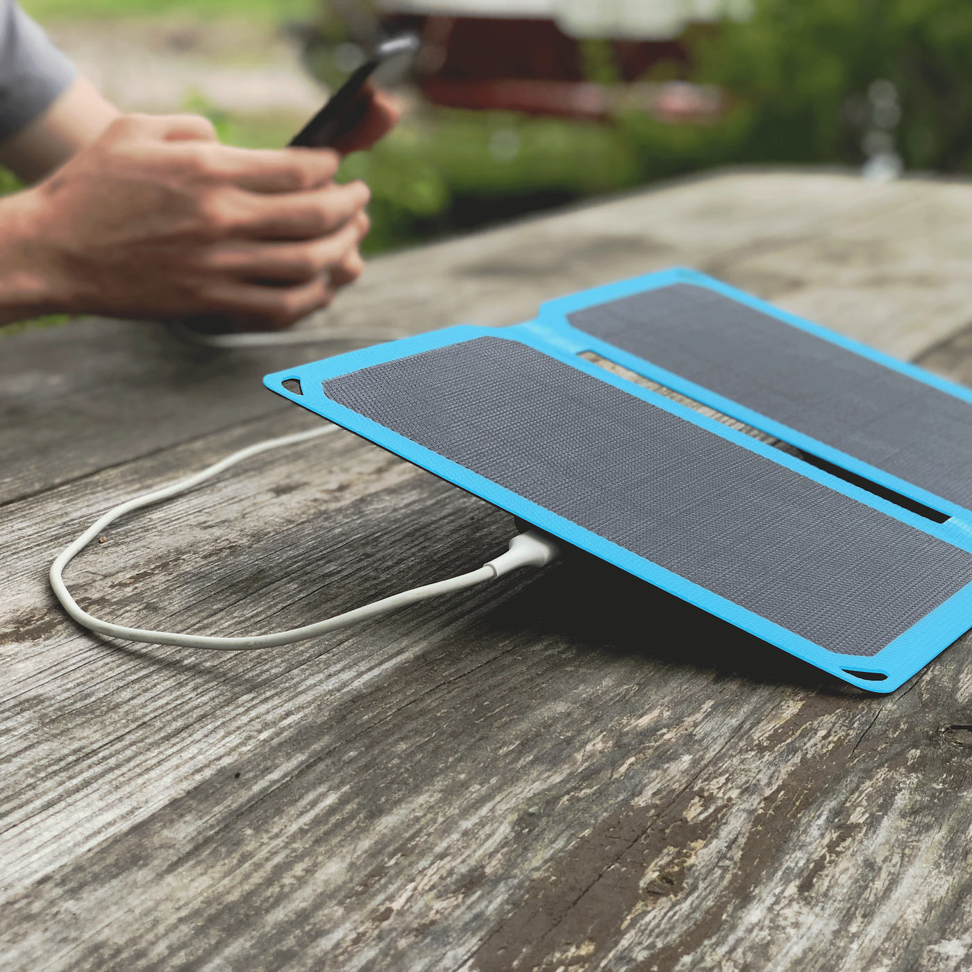 solar phone charger charges a phone