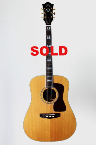 Guild D-55 Acoustic Guitar, with case.