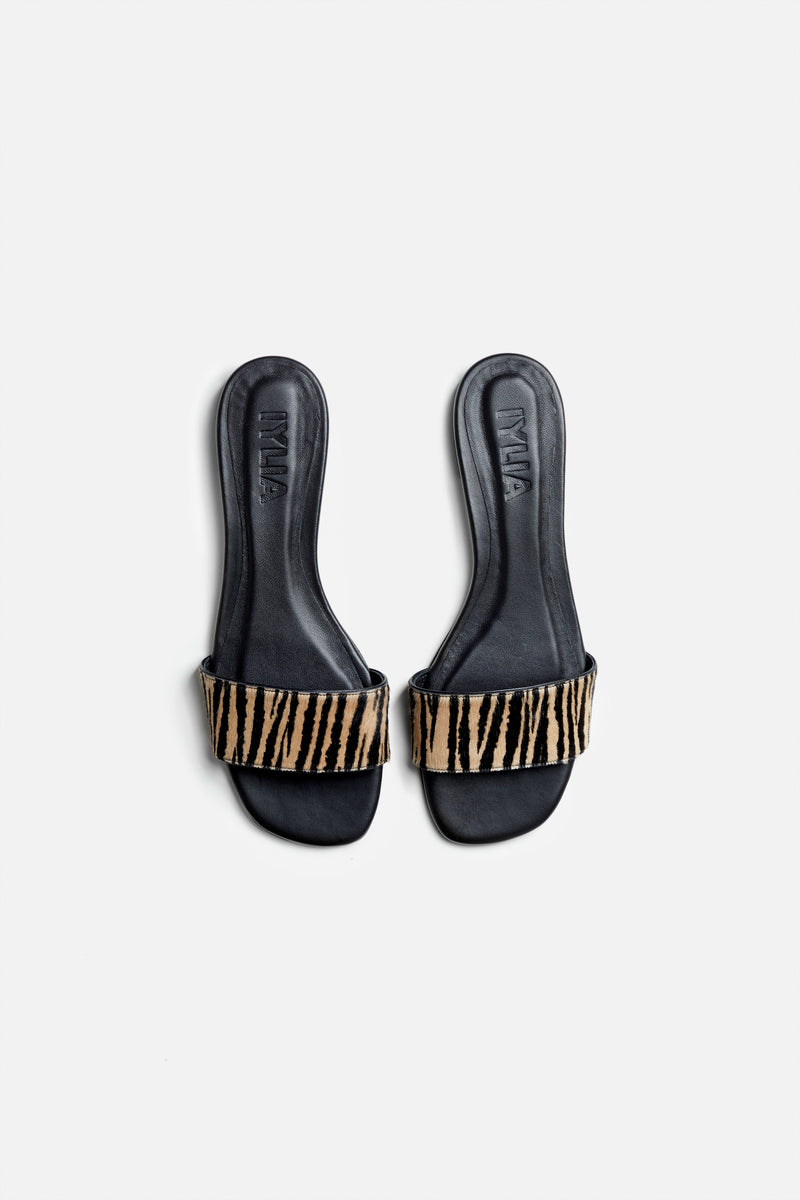 The Coco Slide in Zebra Printed Calf Hair and Black Leather