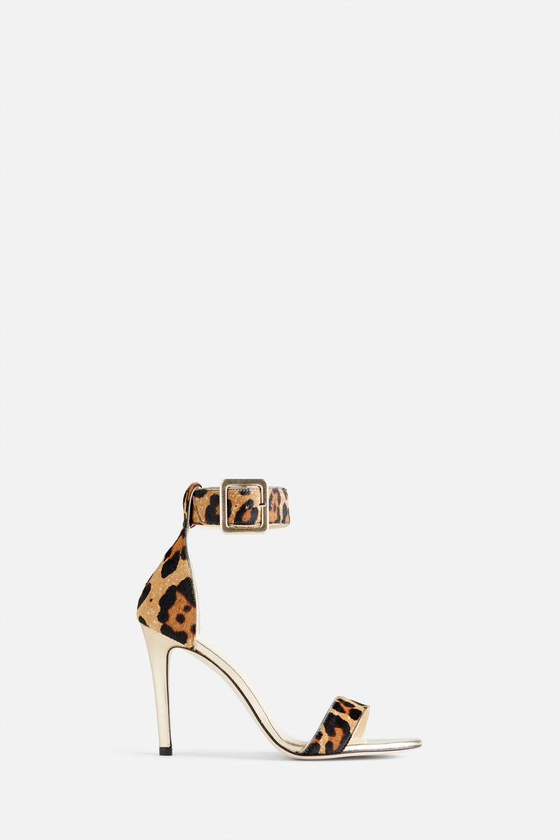 The Kelly Stiletto Sandal in Leopard Printed Calf Hair and Gold Leather