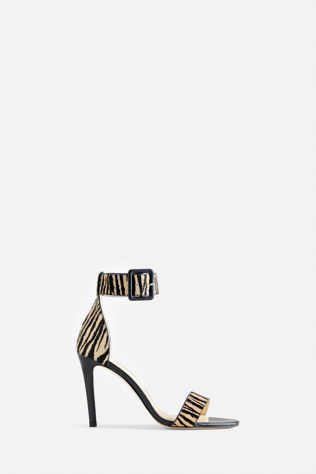 The Kelly Stiletto Sandal in Zebra Printed Calf Hair and Black Leather