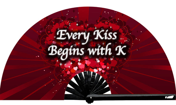 Every Kiss Begins With K fan, from Yuppie Boy, by Wear It!  Find your party accessories for your next rave, music festival, circuit party, or night out at the club at Wear It Apparel! The only place for custom hand fans, plastic fans, bamboo fans, and metal hand fans, neon parasols, and custom parasols and the only place for neon & blacklight fans and parasols. Clack that fan away. #NowWearIt #Clackthatfan