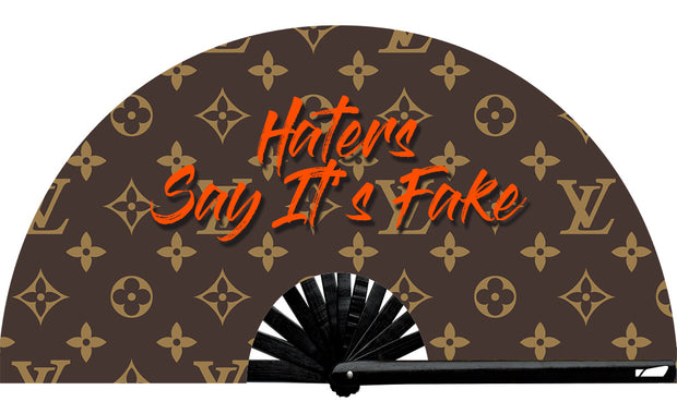 Haters Say It's Fake fan, from Yuppie Boy, by Wear It!  Blacklight / UV responsive!  Find your party accessories for your next rave, music festival, circuit party, or night out at the club at Wear It Apparel! The only place for custom hand fans, plastic fans, bamboo fans, and metal hand fans, neon parasols, and custom parasols and the only place for neon & blacklight fans and parasols. Clack that fan away. #NowWearIt #Clackthatfan