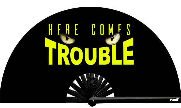Here Comes Trouble Fan, from Yuppie Boy, by Wear It! Blacklight / UV responsive!  Find your party accessories for your next rave, music festival, circuit party, or night out at the club at Wear It Apparel! The only place for custom hand fans, plastic fans, bamboo fans, and metal hand fans, neon parasols, and custom parasols and the only place for neon & blacklight fans and parasols. Clack that fan away. #NowWearIt #Clackthatfan