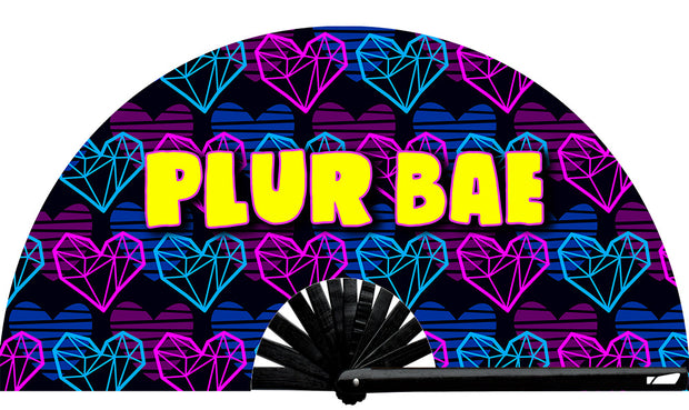 PLUR Bae fan, from Yuppie Boy, by Wear It!  Blacklight / UV responsive!  Find your party accessories for your next rave, music festival, circuit party, or night out at the club at Wear It Apparel! The only place for custom hand fans, plastic fans, bamboo fans, and metal hand fans, neon parasols, and custom parasols and the only place for neon & blacklight fans and parasols. Clack that fan away. #NowWearIt #Clackthatfan