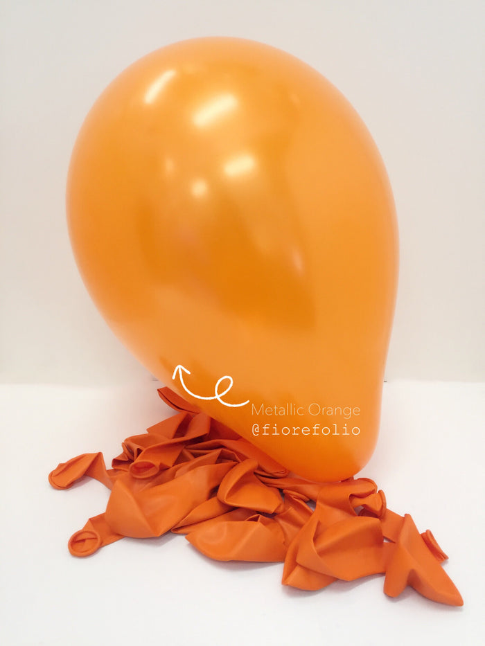 metallic orange helium balloon
