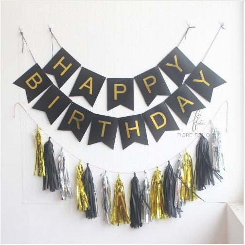 Black and gold happy birthday banner and tassels. black and gold birthday themed decors