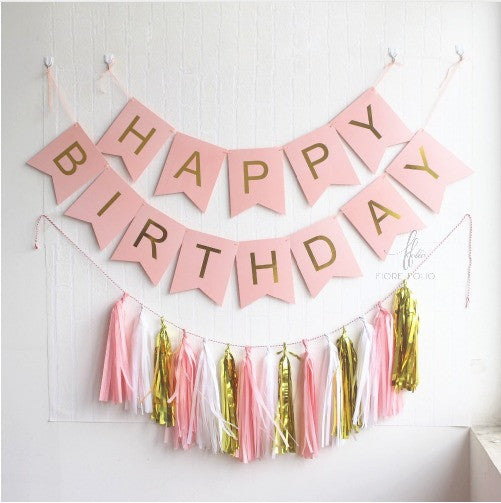 pink happy birthday banner and tassels. pink birthday themed decors