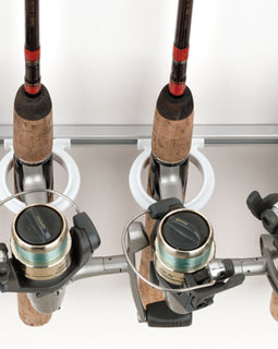 Close up of a custom fishing rod rack holder holding spinning reels.