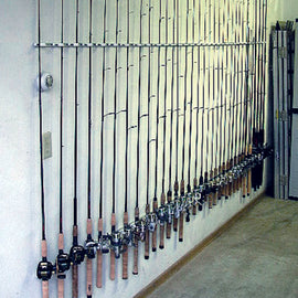 A wall full of high quality fishing rods stored vertically in Dubro's custom fishing rod racks called Trac-A-Rods.