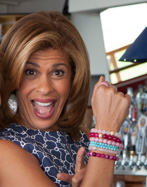 Hoda Ktob wearing Sisco + Berluti bracelets to benefit FORCE